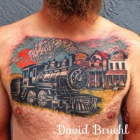 Western style colored train and houses tattoo on chest