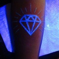 White ink luminescence diamond tattoo