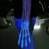 White ink luminescence hand and arm bones realistic tattoo