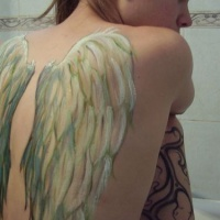 White wings tattoo on back for girls