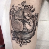 Wild life style cute black and white squirrel with hedgehog tattoo on arm