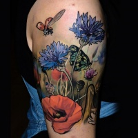 Wildflowers in field colored shoulder lifelike tattoo with ladybug and butterfly