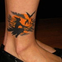 Witch flying on broomstick at night with bats tattoo on ankle with Moon