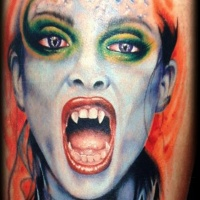 Wonderful colored realistic looking vampire woman tattoo on leg