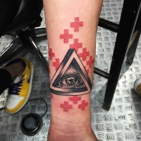 Wonderful colored triangle shaped symbol with human eye tattoo on forearm combined with red crosses