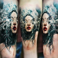 Wonderful colorful detailed mystical woman tattoo stylized with small cross