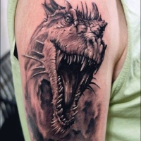 Wonderful detailed black and white dinosaur tattoo on shoulder