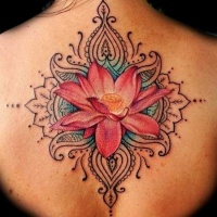 Wonderful elegant lotus tattoo on back