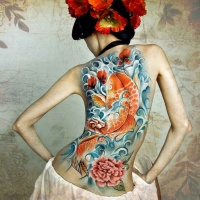 Wonderful koi fish tattoo for girls on back