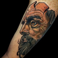 wonderful looking colored biceps tattoo of creepy mans portrait