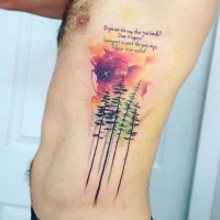 Wonderful looking colored side tattoo of forest with colored clouds and lettering
