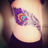 Wonderful painted colored big feather tattoo on waist