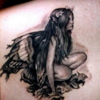 Wonderful sitting fairy tattoo