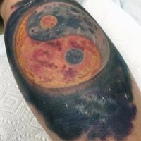 Yin Yang symbol shaped big planet tattoo on leg