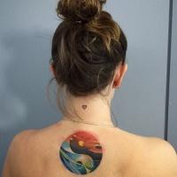 Yin Yang symbol shaped colored back tattoo stylized with sea