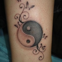 Yin yang tattoo on leg