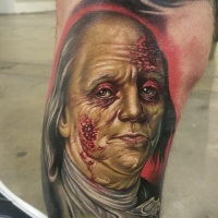 Zombie style colored thigh tattoo of American president portrait