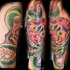 Red desperate horned mask forearm tattoo