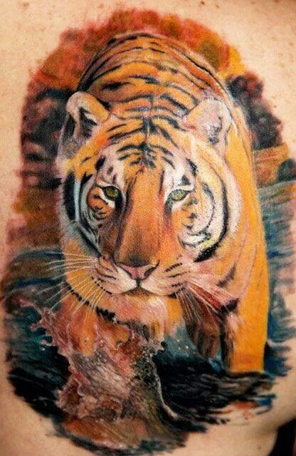 Watercolour tiger in nature tattoo