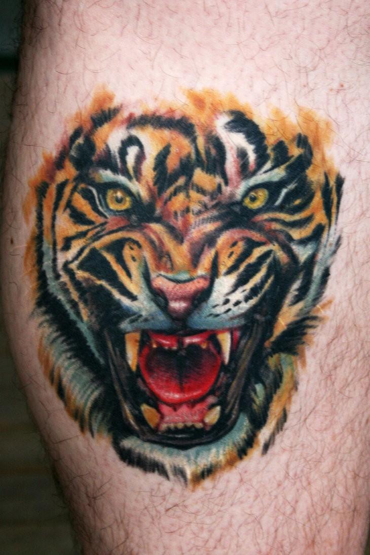 Roaring tiger tattoo on leg
