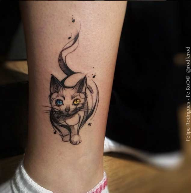 Tiny abstract style mystical cat tattoo on ankle with various colored eyes