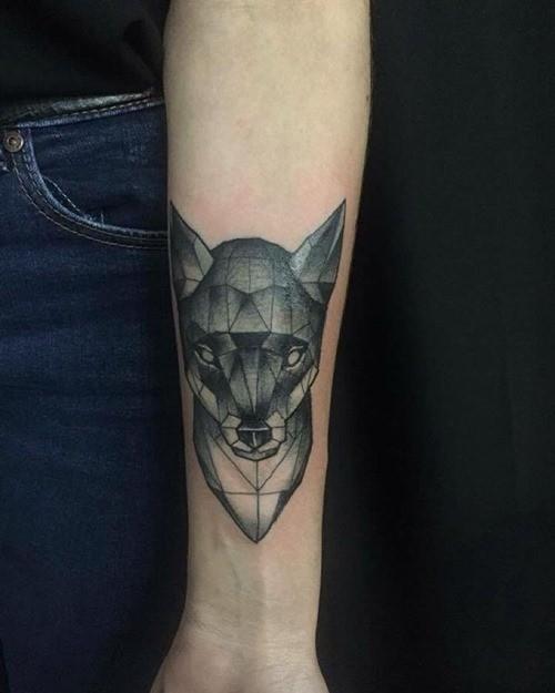 Tiny black and white abstract forearm tattoo of fox head