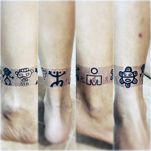 Tiny black ink ankle tattoo of various tribal symbols