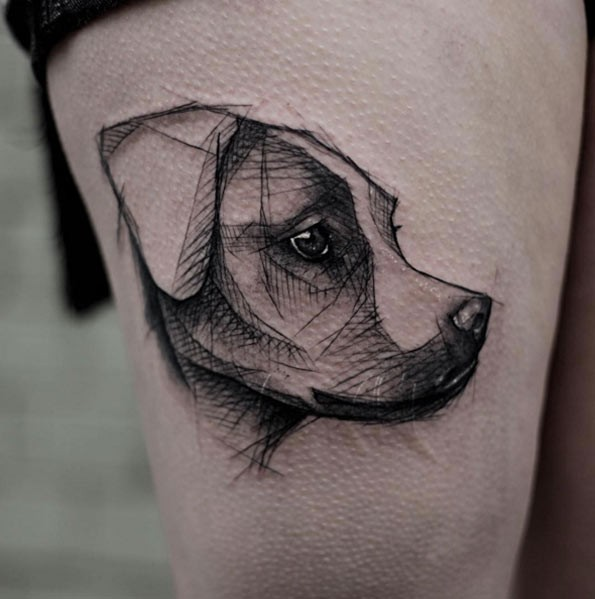 Tiny black ink sketch style thigh tattoo of cute puppy