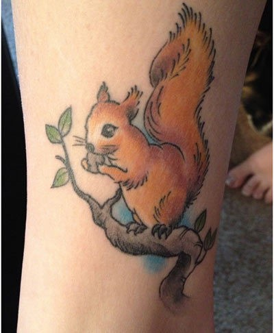 Tiny cartoon like colored cute squirrel tattoo