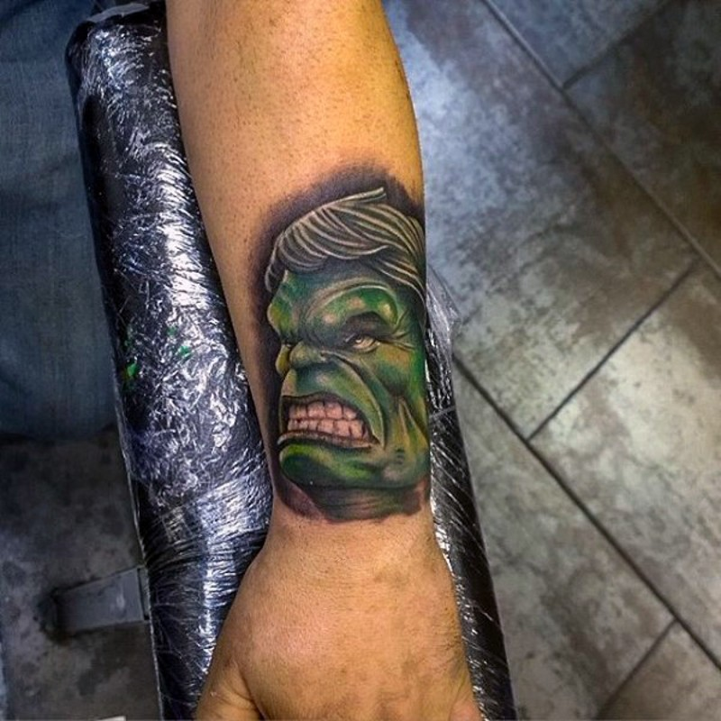 Tiny comic books style colored wrist tattoo of angry Hulk head