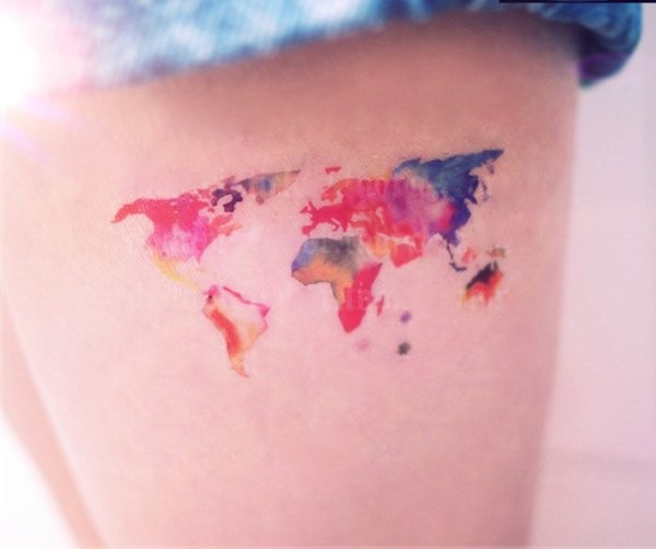 Tiny cute looking colored thigh tattoo of world map tattooimagesz tiny cute looking colored thigh tattoo of world map gumiabroncs Choice Image