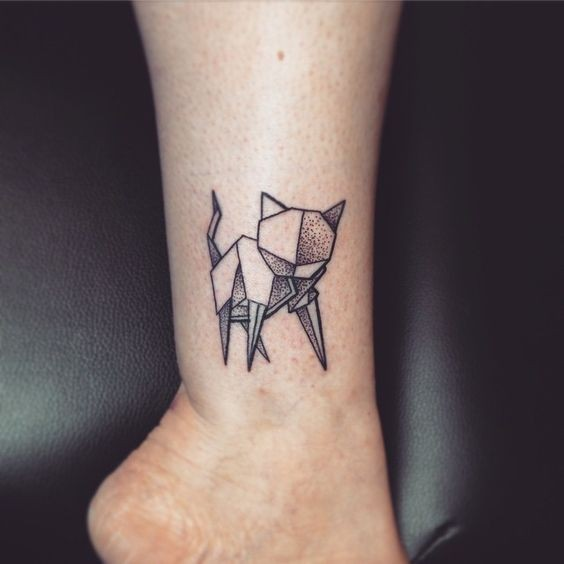 Tiny dot style ankle tattoo of funny looking cat