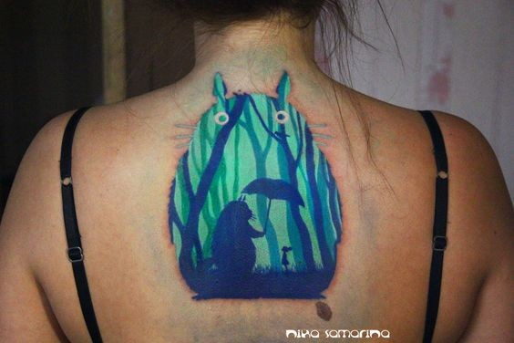 Tiny funny designed colored cartoon creature with umbrella and little girl tattoo on upper back area
