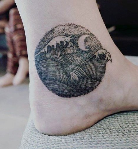 Tiny homemade like black ink waves with moon tattoo on ankle