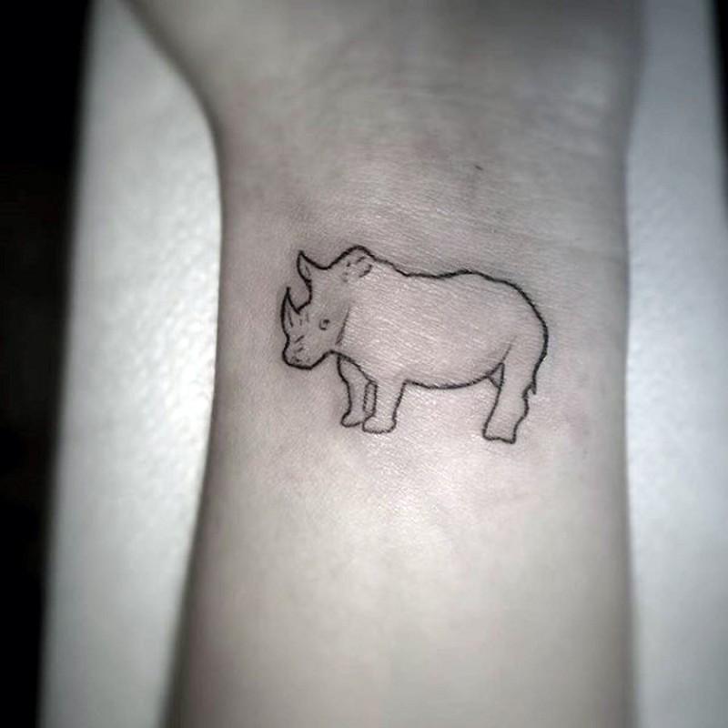 Tiny homemade wrist tattoo of tiny rhino