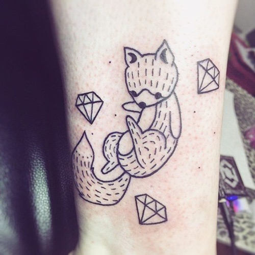 Tiny simple black ink fox tattoo on ankle combined with diamonds