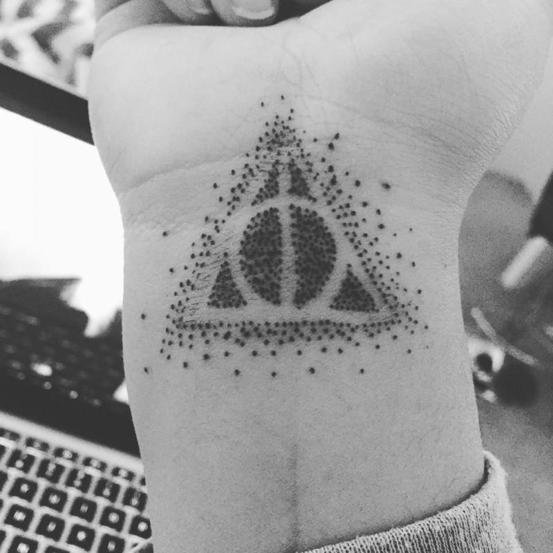 Tiny simple geometrical tattoo on wrist