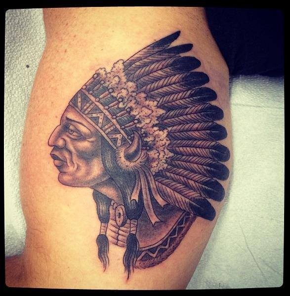 Traditional American Indian chief detailed tattoo on biceps