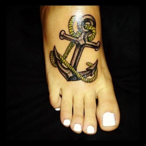 Traditional anchor tattoo on foot