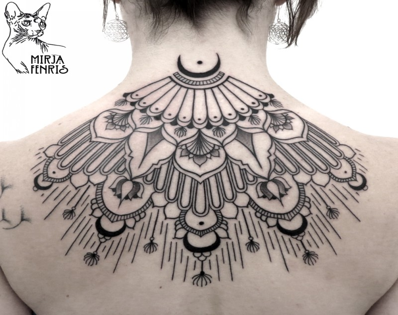 Traditional black ink back tattoo of impressive ornaments