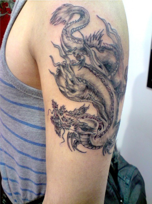 Traditional chinese dragon tattoo on hand