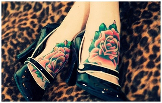 Traditional colored and painted little roses tattoo on feet