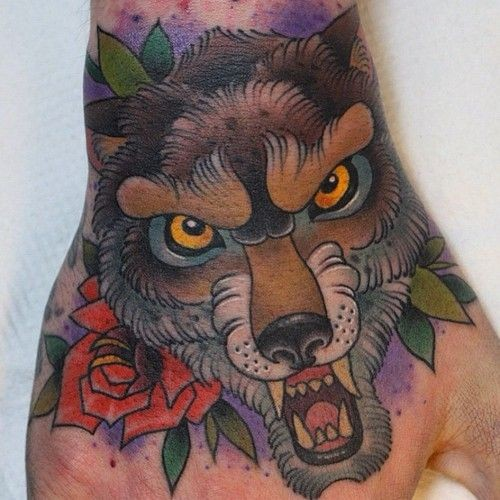Traditional furious wolf and red rose flower colored hand tattoo with violet shadow