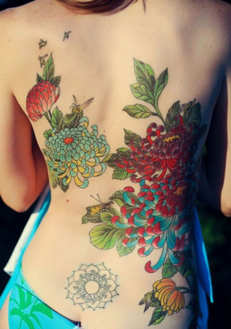 Traditional painted colored chrysanthemum flowers tattoo on back with insects