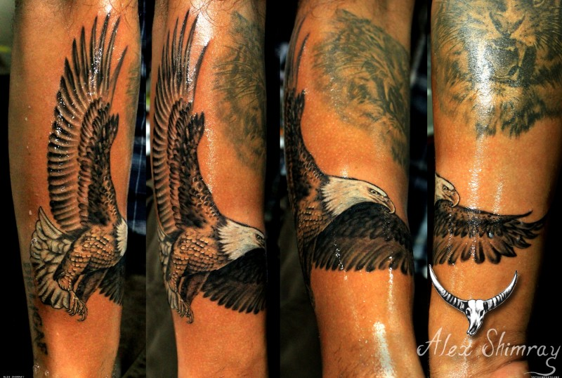 Traditionally colored American patriotic flying eagle detailed tattoo