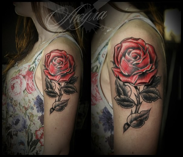 Traditionally colored old school style red rose tattoo on girl&quots shoulder