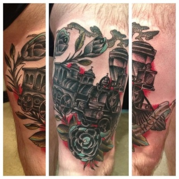 Train memorial colored thigh tattoo of steam train with lettering