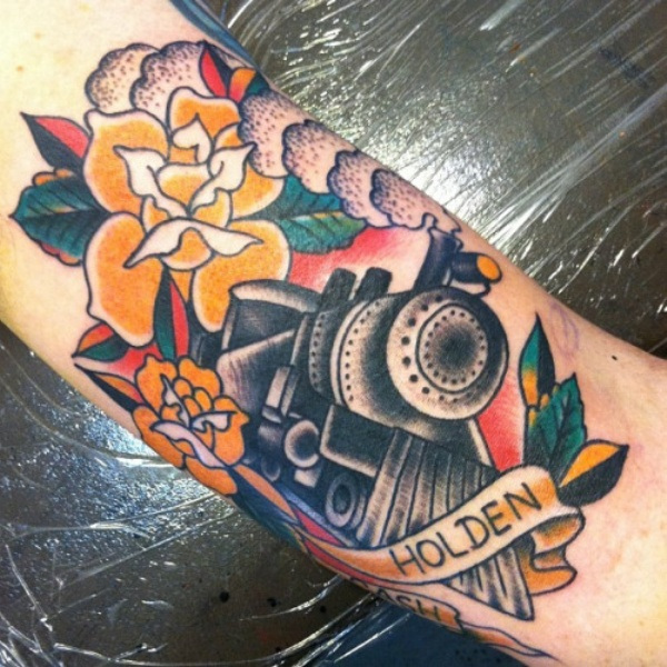 Train with steam colored old school style tattoo with roses and lettering