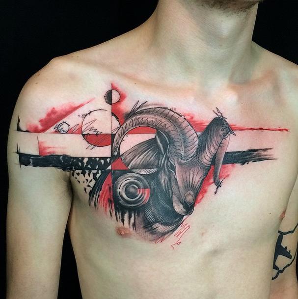 Tatuaggio petto di capra con pianeti in stile Polka Trash