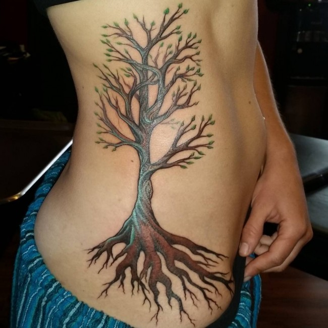 Tree with tiny green leaves and long roots side tattoo